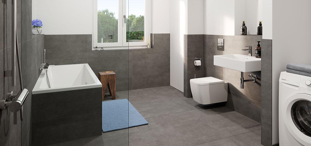 Badezimmer mit grauen Fliesen und hochwertiger Ausstattung, ebenfalls mit Waschmaschinenanschluss